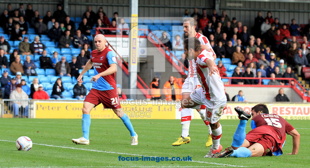 Picture by Richard Gould/Focus Images Ltd +447814 482222.13/10/2012.Harry Forrester scores his side's first goal during the npower League 1 match at Glanford Park, Scunthorpe.