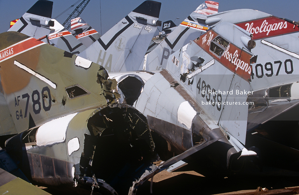 Awaiting recycling are the tails of various Air Force and National Guard of jet fighter aircraft, now junked in the arid desert, on 15th August 1998, at Davis Monthan Air Force Base, Tucson, Arizona, USA.