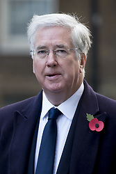 Sir Michael Fallon walks through Downing Street on his way to the annual Remembrance Sunday Service at the Cenotaph memorial in Whitehall, central London, held in tribute for members of the armed forces who have died in major conflicts.