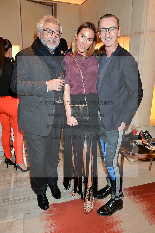 Left to right, ROBERT BENSOUSSAN, ALEX MEYERS and BRUNO FRISONI at the Roger Vivier 'The Perfect Pair' Frieze cocktail party celebrating Ambra Medda & 'Miss Viv' at the Roger Vivier Boutique, Sloane Street, London on 15th October 2014.