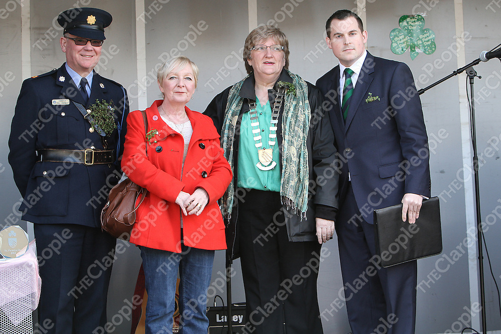Inspector Tom Kennedy, Councillor Cathy McCafferty, Mary Brennan Mayor of Shannon & Chris Harold on the review stand for The Shannon Parade. - Photograph by Flann Howard
