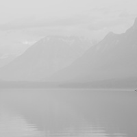 lone kayaker on lake paddling lake mcdonald glacier park,