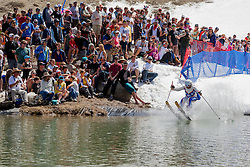 """""""Cushing Classic at Squaw Valley 24"""" - Photograph of a skier crossing a pond during the Cushing Classic at Squaw Valley, USA."""