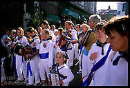 Young accordionists march with elders in early morn kids parade before adult festivities on May Day in Padstow; Cornwall, England.