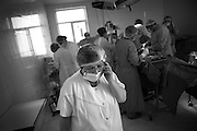"During surgery in a new built operational room in the local hospital in Shushi. This image is part of the photoproject ""The Twentieth Spring"", a portrait of caucasian town Shushi 20 years after its so called ""Liberation"" by armenian fighters. In its more than two centuries old history Shushi was ruled by different powers like armeniens, persians, russian or aseris. In 1991 a fierce battle for Karabakhs independence from Azerbaijan began. During the breakdown of Sowjet Union armenians didn´t want to stay within the Republic of Azerbaijan anymore. 1992 armenians manage to takeover ""ancient armenian Shushi"" and pushed out remained aseris forces which had operate a rocket base there. Since then Shushi became an ""armenian town"" again. Today, 20 yeras after statement of Karabakhs independence Shushi tries to find it´s opportunities for it´s future. The less populated town is still affected by devastation and ruins by it´s violent history. Life is mostly a daily struggle for the inhabitants to get expenses covered, caused by a lack of jobs and almost no perspective for a sustainable economic development. Shushi depends on donations by diaspora armenians. On the other hand those donations have made it possible to rebuild a cultural centre, recover new asphalt roads and other infrastructure. 20 years after Shushis fall into armenian hands Babies get born and people won´t never be under aseris rule again. The bloody early 1990´s civil war has moved into the trenches of the frontline 20 kilometer away from Shushi where it stuck since 1994. The karabakh conflict is still not solved and could turn to an open war every day. Nonetheless life goes on on the south caucasian rocky tip above mountainious region of Karabakh where Shushi enthrones ever since centuries."