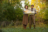(Chicago, Illinois) - October 5, 2013 - Dan and Susan take engagement photos as if they are searching for dinosaurs in Peterson Park in early Autumn. <br /> <br /> Photo by Will Nunnally / Will Nunnally Photography
