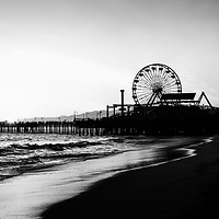 Santa Monica Pier black and white photography. Santa Monica Pier is a landmark that has an amusement park with a ferris wheel, roller coaster, restaurants, and other attractions. Image Copyright © 2012 Paul Velgos with All Rights Reserved.