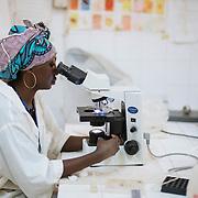 Aminata cisse using the microscope. Koulikoro Hospital, Mali