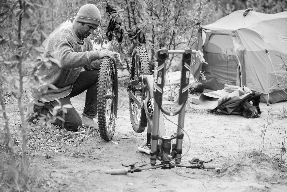 Darren Berrecloth works on this bike at camp in the Tatshenshini-Alsek Provincial Park in British Columbia, Canada on September 1, 2016.