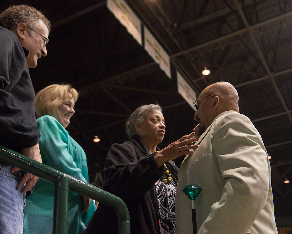 December 5, 2015 - Fairfax, VA - A day in the life of &quot;Doc Nix,&quot; aka Dr. Michael Nickens, the Director of the Athletic Bands for George Mason University. Here Doc NIx talks to his mother, Linda Nickens, and friends during the game.<br /> <br /> <br /> Photo by Susana Raab