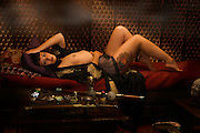 "Am I not desirable? Seductive, beautiful woman in a very erotic pose,  portrayed by alternative model Sabrina Sin, smoking opium in an ornate pipe, a forbidden pleasure among the liberated French females of the 1930's. She is being carried away by the effects of the drug surrendering herself to the drug. This collection was inspired by the writings of Brassai in his book ""The Secret Paris of the 1930's""."
