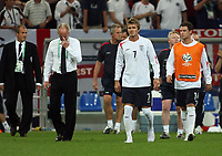 Photo: Chris Ratcliffe.<br /> England v Portugal. Quarter Finals, FIFA World Cup 2006. 01/07/2006.<br /> Sven Goran Eriksson of England and David Beckham walk on the pitch at the end.