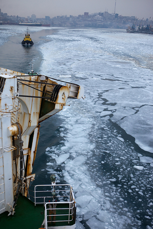 "Ice is covering the exit of Vladivostok port and the cruiser ""Eastern Star"" is guided by navigators into direction South Korea. Photography : Björn Steinz"