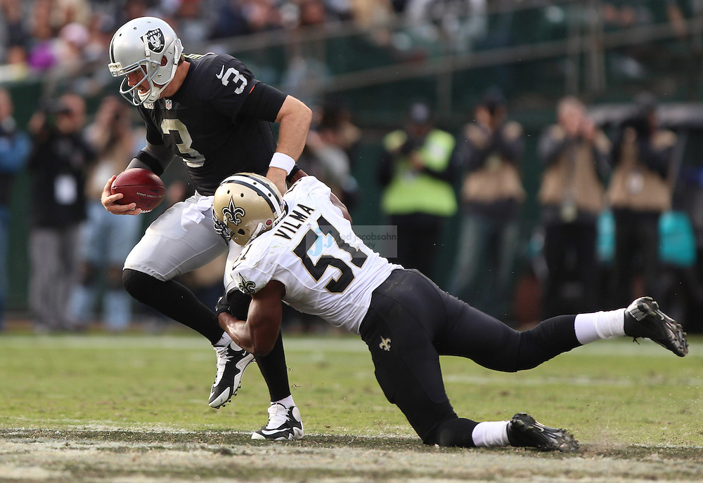 Oakland Raiders quarterback Carson Palmer (3) is sacked by New Orleans Saints linebacker Jonathan Vilma (51) during an NFL game on Sunday, Nov. 18, 2012 at the Oakland Coliseum in Oakland, Ca. (AP Photo/Jed Jacobsohn)