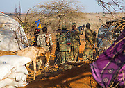 DROUGHT IN ETHIOPIA<br /> <br /> The Borana tribe, part of Oromo people who make up around a third of the Ethiopian population, is suffering from drought for months. Cows are dying, meanwhile many people are complaining the lack of support from the government, thus generating massive uprisings, repressions and killing hundreds of protesters.<br />  Borana live in Kenya, Ethiopia and Somalia with a population of 500,000. They are semi pastoralists. Their life depends on their livestock, which are their only wealth. Their cattle are used in sacrifices and also as dowry or to pay legal fines. For one year, there has been no rain and more than 15,000 cows have died in Ethiopia.<br /> <br /> Photo shows: Soldiers with kalashnikovs during the Gada system ceremony, Oromia, Yabelo, Ethiopia<br /> ©Eric lafforgue/Exclusivepix Media