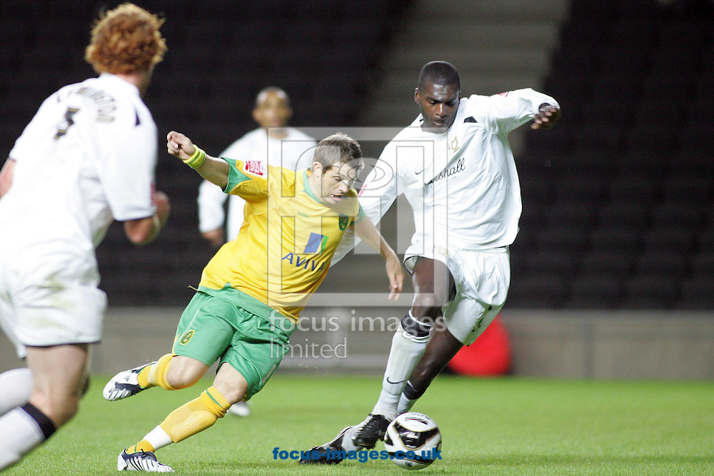 Milton Keynes - Tuesday, August 12th, 2008: Jude Stirling (R) of MK Dons and Jamie Cureton (L) of Norwich City during the Carling League Cup First Round match at Stadium MK, Milton keynes. (Pic by Mark Chapman/Focus Images)