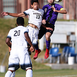Carroll's Jose Porras collides with Southern Oregon's Gonzalo Garcia during Sunday's game at Nelson Stadium. The Saints' lost 3-1 to the Raiders.