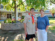 North Merrick, New York, U.S. September 11, 2019. L-R, NICHOLAS CARRANO, 15, of Merrick, a member of Boy Scout Troop 123, and Park Avenue School Principal EILEEN SPEIDEL pose for photo after outdoor remembrance ceremony on 18th Anniversary of terrorist attacks on Sept. 11, 2001.