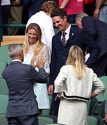 Justin and Kate Rose in the royal box of centre court on day thirteen of the Wimbledon Championships at The All England Lawn Tennis and Croquet Club, Wimbledon.