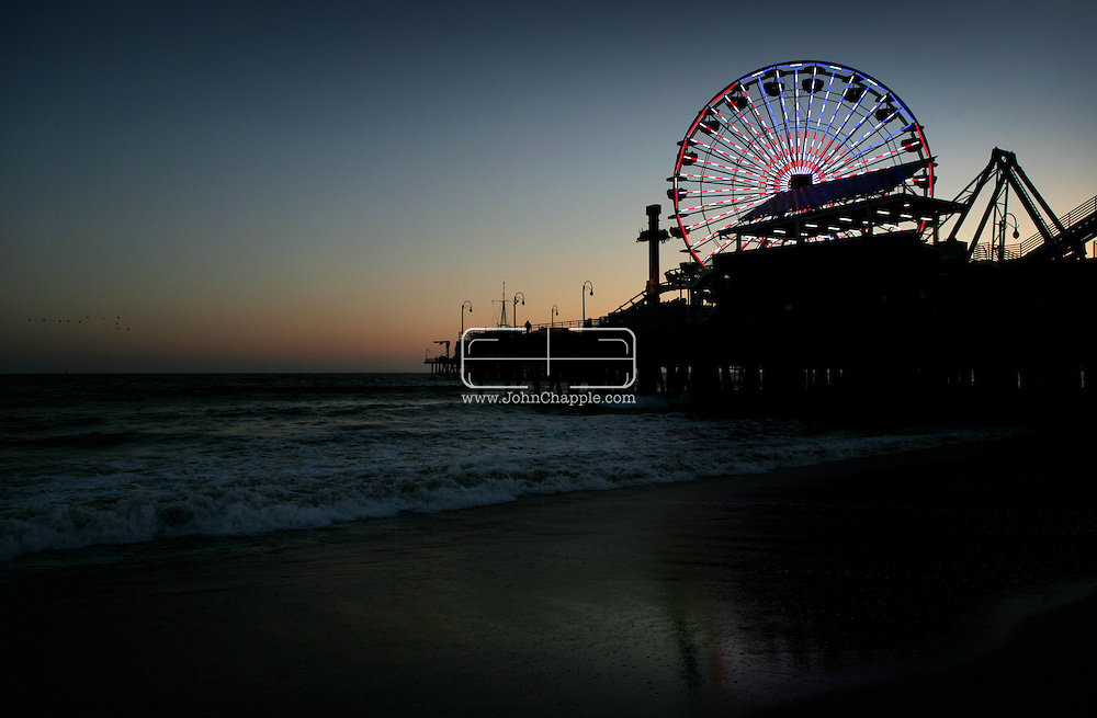 "30th May 2008, Santa Monica, California. One of Southern California's oldest landmarks, the Santa Monica Pier, showed off a brand new $1.5-million Ferris wheel. With 160,000 LED lights it is 75 percent more energy efficient than the last wheel. The previous wheel, seen in 28 movies, including the current hit ""Ironman"", was auctioned on Ebay for $132,000. PHOTO © JOHN CHAPPLE / REBEL IMAGES.john@chapple.biz   www.chapple.biz"