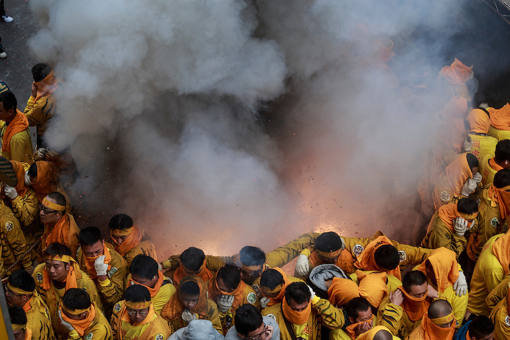 Thousands of firecrackers are let off at once during a religious festival.
