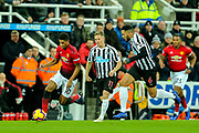 Marcus Rashford (#10) of Manchester United drives the ball forward pursued by Matt Ritchie (#11) of Newcastle United and Jamaal Lascelles (#6) of Newcastle United during the Premier League match between Newcastle United and Manchester United at St. James's Park, Newcastle, England on 2 January 2019.