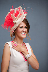 LIVERPOOL, ENGLAND - Friday, April 4, 2014: Tanya Walsh from Carlisle wearing Celeb Boutique and hat from Annmarie Boutique of Lockerby during Ladies' Day on Day Two of the Aintree Grand National Festival at Aintree Racecourse. (Pic by David Rawcliffe/Propaganda)
