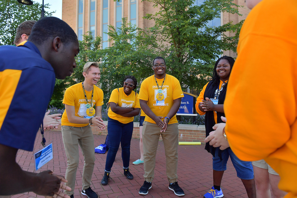 Members of the gold Flashguide team play a quick game while waiting for their tour group during Destination Kent State.