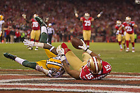 12 January 2013: Wide receiver (15) Michael Crabtree of the San Francisco 49ers scores a touchdown against the Green Bay Packers during the first half of the 49ers 45-31 victory over the Packers in an NFL Divisional Playoff Game at Candlestick Park in San Francisco, CA.