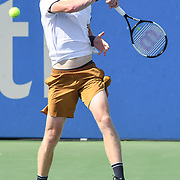 KYLE EDMUND hits a forehand at the Rock Creek Tennis Center.