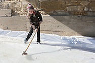 Kaitlyn Kulbartz, 8, of Blairstown, connects on a pork chop in the Porkchop SlapShot competition during Winterfest at the Amana Colonies in Amana on Saturday, January 26, 2013.