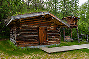 "Jack London's Cabin replica in Dawson City, Yukon, Canada. Jack London (1876–1916) was an American novelist, journalist, and social activist. At age 21, he spent a difficult winter 1897–1898 prospecting for gold from in a rented cabin on the North Fork of Henderson Creek, 120 km south of Dawson City, just prior to the gold rush of 1898. While he didn't strike it rich, he later turned his Klondike adventures into fame and fortune with legendary short stories and books. His most famous works include ""The Call of the Wild"" and ""White Fang"", both set during the Klondike Gold Rush. A pioneer in the world of commercial magazine fiction, he was one of the first writers to become a worldwide celebrity and earn a fortune from writing. He was also an innovator in the genre that would later become known as science fiction. Born as John Griffith Chaney, his last name become London through his mother's remarriage during his first year of life. He began calling himself Jack as a boy. London's cabin, abandoned after the Gold Rush, was re-discovered by trappers in 1936 who noted London's signature on the back wall. Yukon author Dick North organized a search in 1965 and eventually had the cabin dismantled and shipped out. Two replicas were made from the original logs. One is shown here in Dawson City, while the other was re-assembled at Jack London Square in Oakland, California, London's hometown."