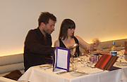 Avril Mair and Wolfgang Tillmans. I.D. magazine dinner for John Dempsey of Mac cosmetics, Fifth floor restaurant, Harvey Nichols. 17 December 2002. © Copyright Photograph by Dafydd Jones 66 Stockwell Park Rd. London SW9 0DA Tel 020 7733 0108 www.dafjones.com