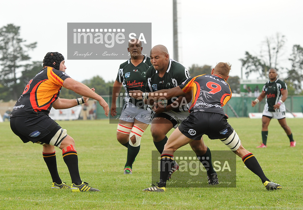GEORGE, SOUTH AFRICA - Saturday 7 March 2015, Anvor Prins of Pacaltsdorp Evergreens runs into Wesley Flanagan of Vaseline Wanderers during the third round match of the Cell C Community Cup between Pacaltsdorp Evergreens and Vaseline Wanderers at Pacaltsdorp Sports Grounds, George<br /> Photo by Roger Sedres/ImageSA/ SARU