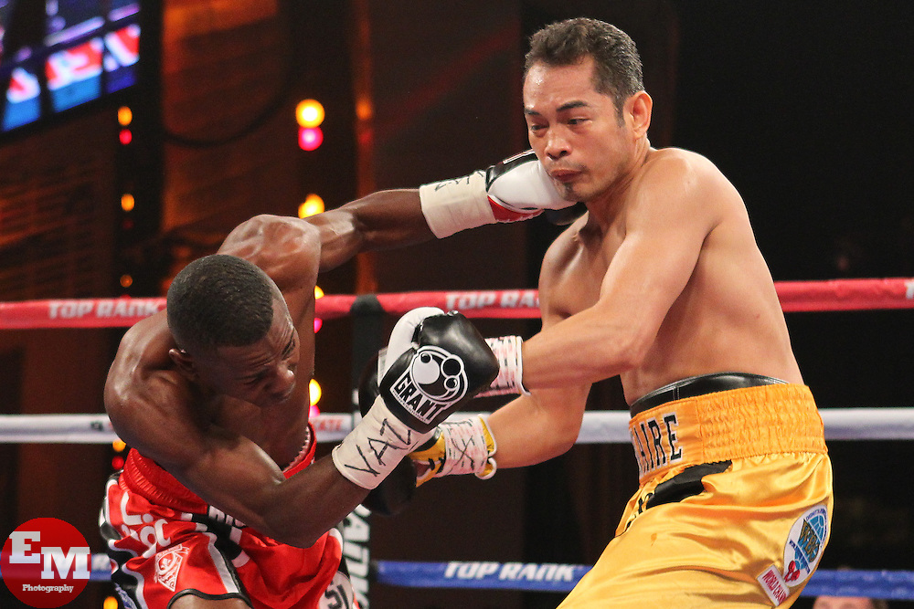 Apr 13, 2013; New York, NY, USA; Nonito Donaire (Yellow/Black Trunks) and Guillermo Rigondeaux (Red/black trunks) trade punches during their 12 round WBO/WBA Super Bantamweight title fight at Radio City Music Hall.