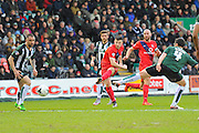 York City's Bradley Fewster has a long range shot during the Sky Bet League 2 match between Plymouth Argyle and York City at Home Park, Plymouth, England on 28 March 2016. Photo by Graham Hunt.