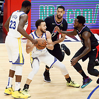 LOS ANGELES, CA - APR 26: Stephen Curry (30) of the Golden State Warriors vies for the ball with Garrett Temple (17) of the LA Clippers and Patrick Beverley (21) of the LA Clippers during Game 6 of the Western Conference First Round on April 26, 2019 at the Staples Center, in Los Angeles, California.