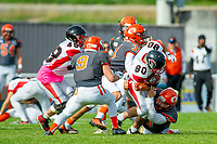 KELOWNA, BC - OCTOBER 6:  Lucas Spencer #70 of Okanagan Sun tackles Jared Braun #80 of the VI Raiders during BCFC regular season at the Apple Bowl on October 6, 2019 in Kelowna, Canada. (Photo by Marissa Baecker/Shoot the Breeze)