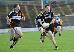 Louisburgh&rsquo;s James Gibbons gets past Kilmeena&rsquo;s Conor Madden during the county junior semi-final at McHale Park.<br />Pic Conor McKeown