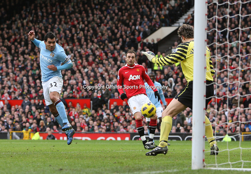 12/02/2011 - Barclays Premier League - Manchester United vs. Manchester City - Man Utd goalkeeper Edwin van der Sar saves from Carlos Tevez of Man City at close range - Photo: Simon Stacpoole / Offside.