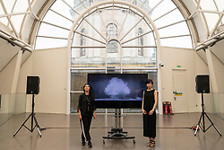 © Licensed to London News Pictures. 06/08/2020. London, UK. Artist Es Devlin and artist Machiko Weston pose next their new Imperial War Museum video commission 'I Saw The World End'. The work commemorates the 75th Anniversary of the bombings of Hiroshima an d Nagasaki. Photo credit: Ray Tang/LNP