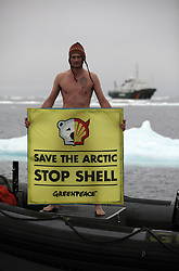 USA ALASKA CHUKCHI SEA 29JUL12 - Sune Scheller of Denmark stands naked as a Greenpeace boat crew protest Shell drilling plans near a proposed drill site in the Chukchi Sea north of Point Hope, Alaska....Photo by Jiri Rezac / Greenpeace....© Jiri Rezac / Greenpeace