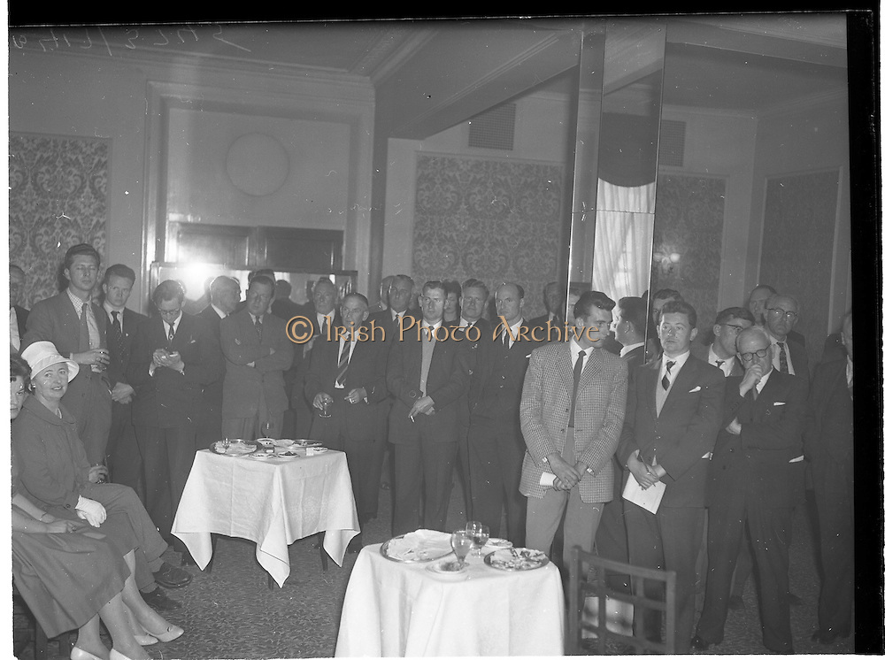 "30/05/1960<br /> 05/30/1960<br /> 30 May 1960<br /> W.D. & H.O. Wills and Gael Linn press conference on new collaboration at the Hibernian Hotel Dublin. Image shows a general view of the press conference. Film concerned most likely ""Peil""."