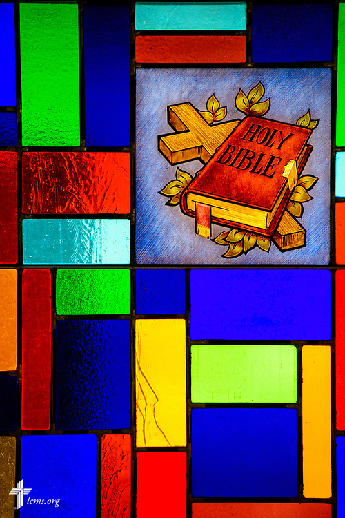 Stained glass depicting the Holy Bible and cross at Zion Lutheran Church, Worms, Neb., on Saturday, Sept. 23, 2017. LCMS Communications/Erik M. Lunsford