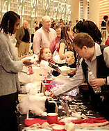 Ballet watchers turn into merchandise customers during intermission of the Wintergreen area of the Schuster Performing Arts Center, Saturday night, March 17th.
