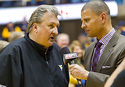 West Virginia Mountaineers head coach Bob Huggins speaks with ESPN after beating the Texas Longhorns at the WVU Coliseum.