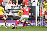 Burnley midfielder, Joey Barton (13) stopping a shot from Charlton Athletic midfielder, Callum Harriott (11) during the Sky Bet Championship match between Charlton Athletic and Burnley at The Valley, London, England on 7 May 2016. Photo by Matthew Redman.