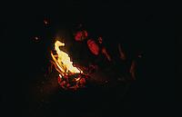 Kathmandu, 07 February 2005. Children light a fire to keep warm.