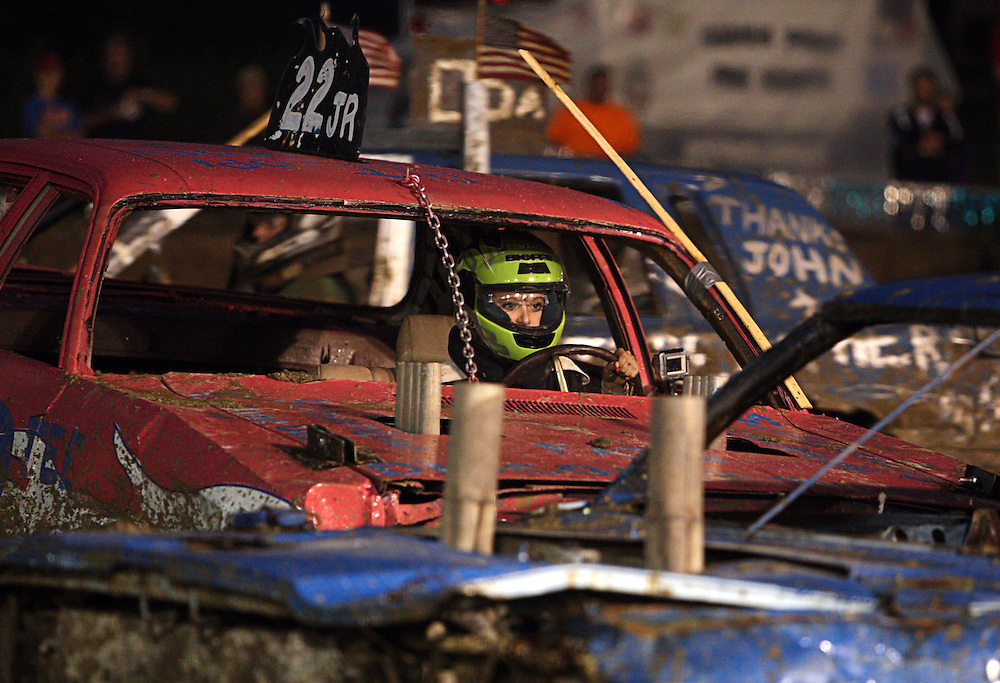 CROWN POINT   Taylor Krieter drives in her first demolition derby at the Lake County Fair in Crown Point on Saturday August, 13, 2011.