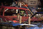 CROWN POINT | Taylor Krieter drives in her first demolition derby at the Lake County Fair in Crown Point on Saturday August, 13, 2011.